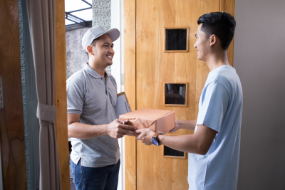 man receiving a delivery at home